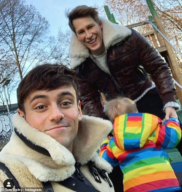 Family: Tom is married to Dustin Lance Black and the pair share son Robbie, three (pictured)