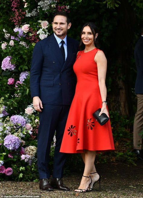 Looking good: The TV presenter, 42, cut a ruby red midi dress, which featured flower-shaped cutouts, as she put on a loved-up display with the former Chelsea player, 43