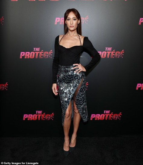 Bringing the drama:The 42-year-old actress posed on the red carpet in an eye-catching mirrored pencil skirt with a dramatic slit that exposed her toned legs