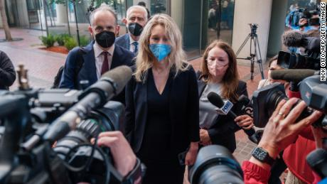 Elizabeth Holmes, the founder and former CEO of blood testing and life sciences company Theranos, arrives for the first day of jury selection in her fraud trial, outside Federal Court in San Jose, California on August 31, 2021.