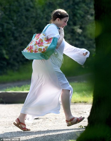 Sandals: Mary teamed her dress with open-toe sandals and wore her hair up