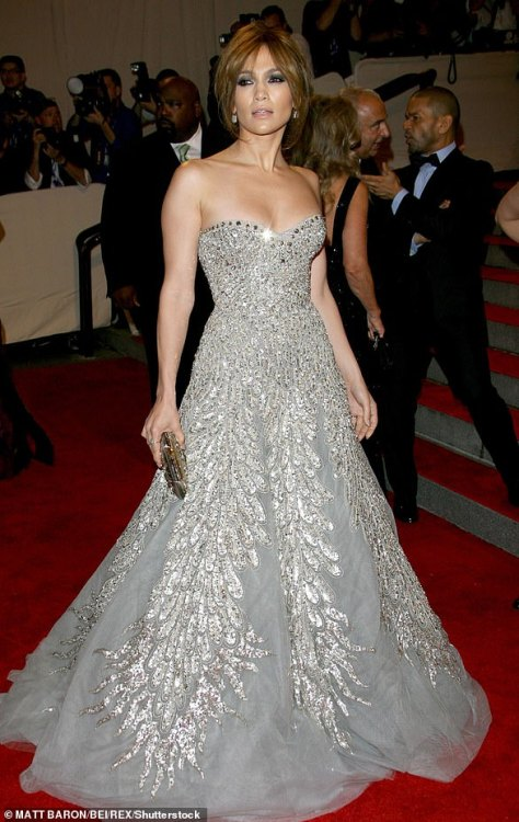 In 2010: This year the Back-Up Plan star returned to Hollywood glamour with a sparkly strapless silver Cinderella style dress as she wore her hair up