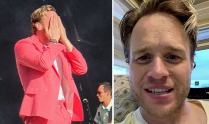 """Olly Murs leaves with """"stinging"""" eyes after fan throws an item at him during first gig post injury"""