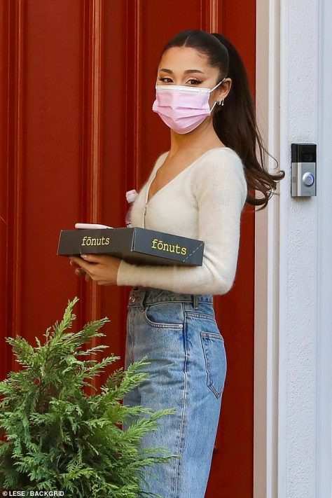 Generous guest: Ariana Grande was spotted arriving at a friend's home on Friday as she carried a box of Fonuts donuts