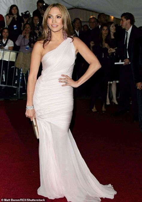 In 2006: It was a drastic change in 2006 as Jenny From The Block opted for a one-shoulder gown in a soft white color with a sheer mermaid finish and her hair down