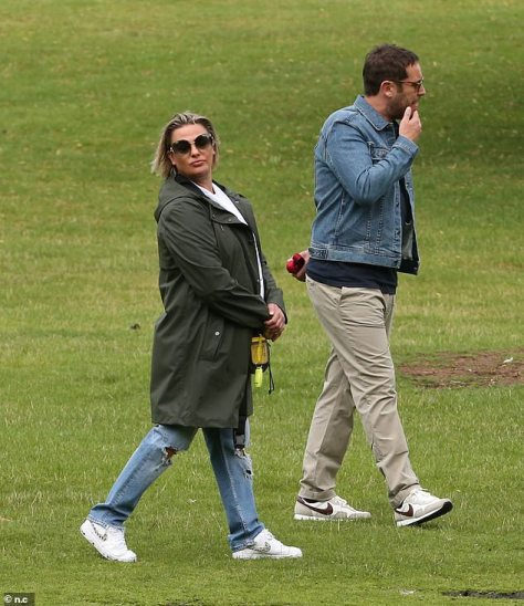 Delightful duo: Lisa certainly seemed in high spirits on her outing with James as they made their way around the park together
