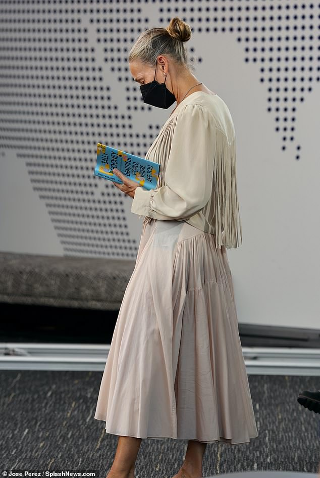 Light reading:Between takes, SJP entertained herself with a bit of light reading, pulling out Sally Rooney's Beautiful World, Where Are You