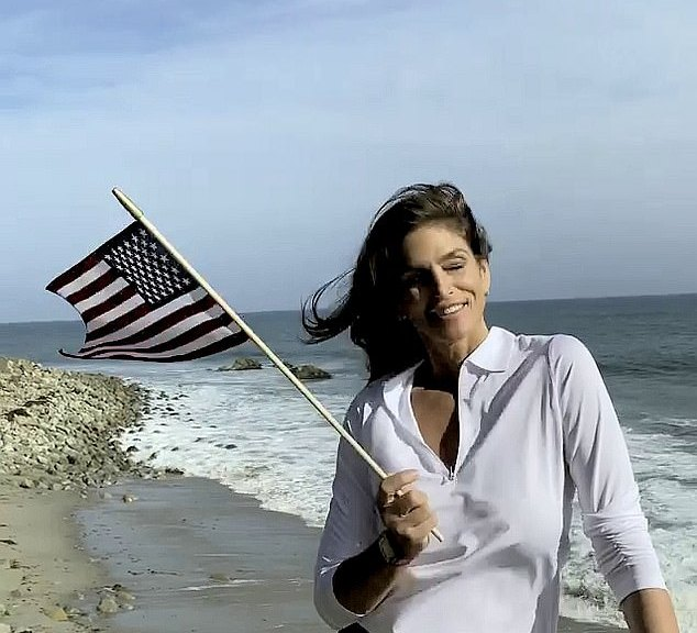 Cindy Crawford wave the American flag during the celebrations of the Olympic athletes