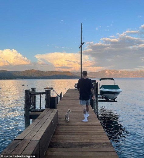 Follow the leader: Another snap showed Biebs as he walked down the dock with his pup in tow
