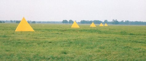 series of yellow tents in a field