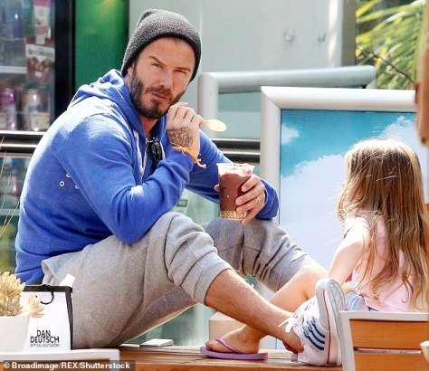 A source said:They had their team negotiate with the chain to get one of the machines especially for them to bring a bit of US culture over' (David pictured with daughter Harper in 2015)