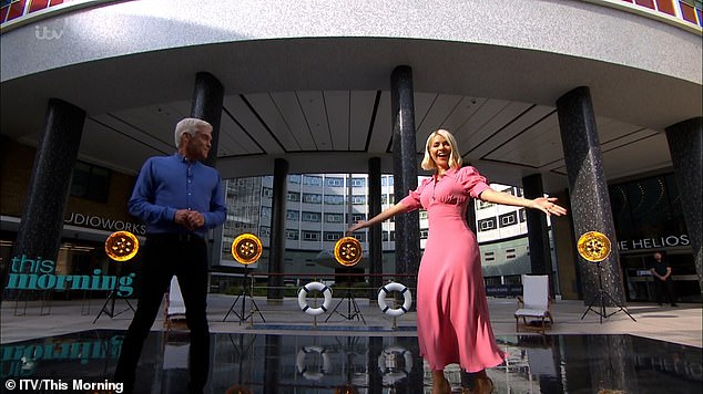 Dancing queen: The fan favourite presenting duo were standing outside the ITV studios as they introduced the cast of Anything Goes