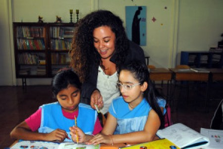 Bianca Villasenor, FrancisCorps class of 2014, tutors young girls to read in Alajuela, Costa Rica.