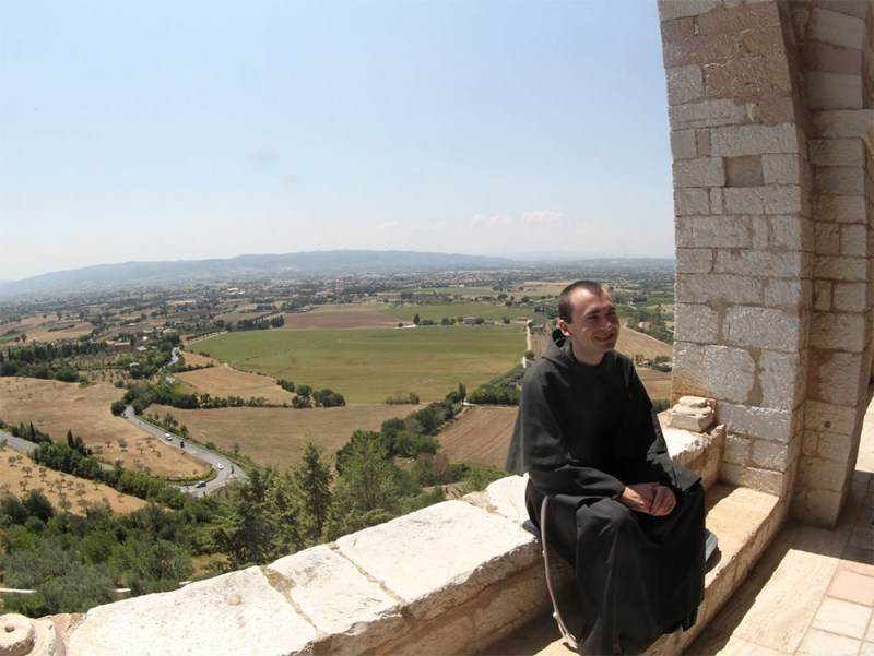 Friar Chris Dudek, OFM Conv. enjoys the view from the Porticato of the Sacro Convento. Friar Chris is an Our Lady of the Angels Province friar who professed his Solemn Vows on August 2, 2015, the Feast Day of our Province.