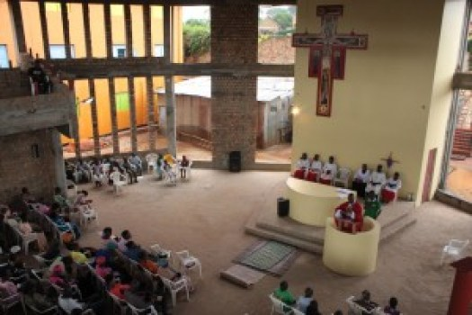 Fr. Edward Wambua, OFM Conv., celebrating Mass in the newly constructed St. Francis of Assisi Church in Matugga, Uganda. The Friars in Matugga need to raise $23,000 to install glass in the windows of the church.
