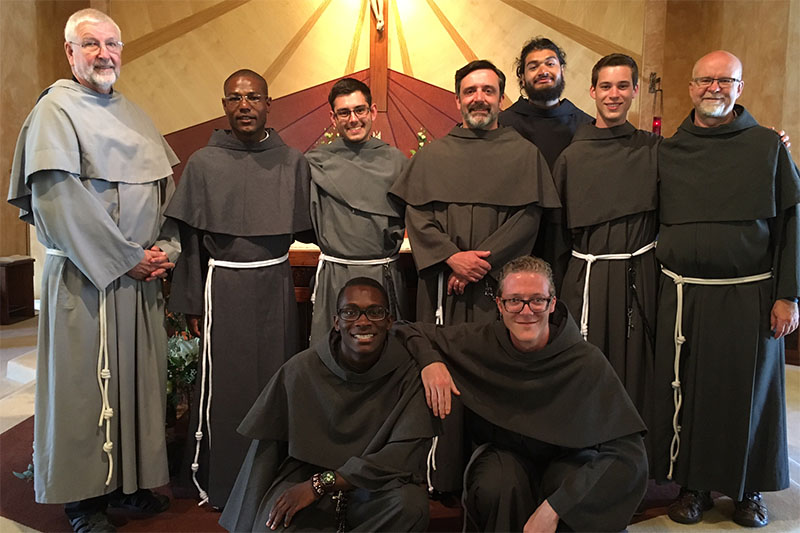On July 21, 2016 the Franciscan Friars Conventual of North America celebrated the joy of the Profession of Simple Vows (also known as First or Temporary) Vows of seven Novices, at St. Paul's Church, in Pismo Beach, California. Congratulations go to Friar Roberson Lubin,, Friar Jacob Minjarez, Friar Brian Mary Tougher, Friar Jaime Zaragoza, Friar Timothy Blanchard, {bottom row} Friar Franck Lino Sokpolie, and Friar Marco Antonio Didden. Many thanks go to their Novitiate Formators: Director Fr. Giles Zakowicz, OFM Conv. (far left, back), and Assistant Director Fr. Maurice Richard, OFM Conv. (far right, back)!