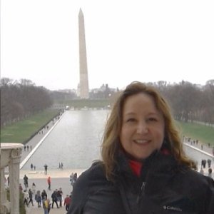 Photo of Amy Bacher standing near the Capitol Mall in Washington DC