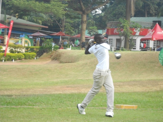 Baguma teeing off aiming hole twelve