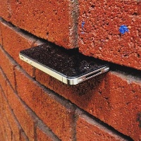 iPhone in a brick wall