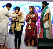 photo-4-geeta-babita-phogat-being-felicitated-matru-trust-founder-mla-dr-sudhakar-akshar-yoga-founder-grand-master-akshar-seen-in-the-pic