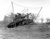 2nd Armored Division, M36 Jackson tank destroyer on dug-in ramp has plenty of elevation to hurl shells at long range enemy targets across the Roer River during the Battle Of The Bulge