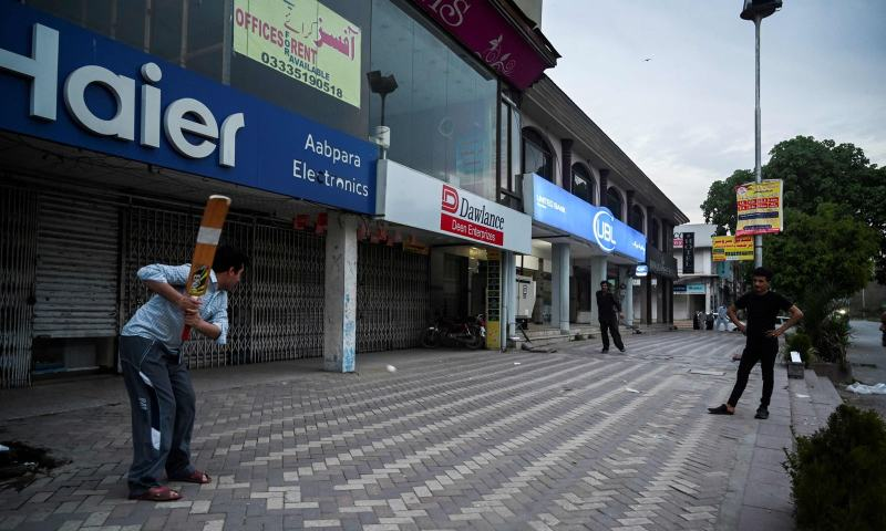 Boys playing cricket on streets of Islamabad during coronavirus lockdown
