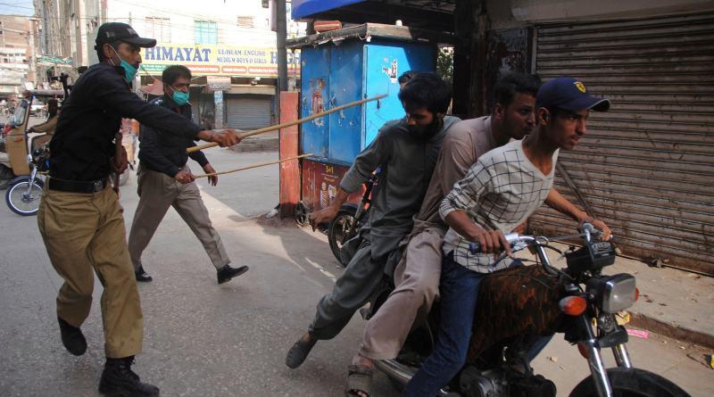 police beating boys on violating lockdown in karachi