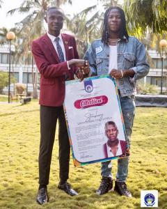 H.E the president/CEO of PUSAG Alswel Annan doing the presentation to Stonebwoy