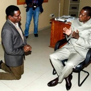 zambia minister kneels down