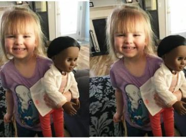 while girl with black doll