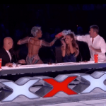Mel B throws cup of water at Simon Cowell