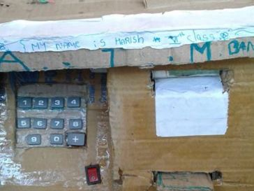 Talented Boy Constructs Mini-ATM That Automatically Releases Paper [Photos, Video]