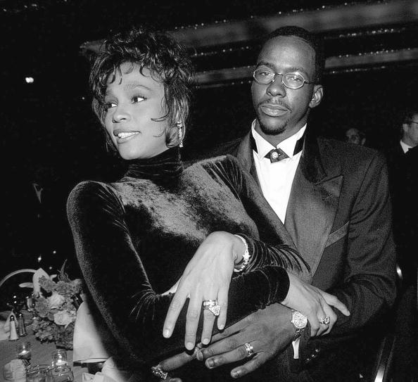 Whitney Houston and husband Bobby Brown at a T.J. Martell be