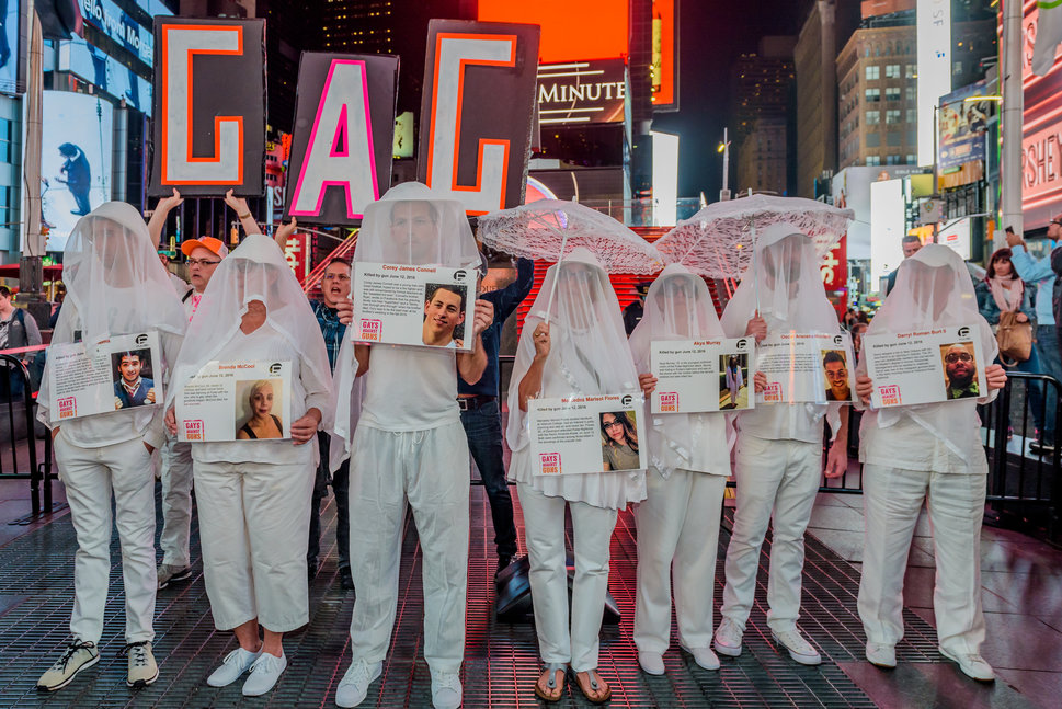 At the Gays Against Guns demonstration in New York after the Las Vegas massacre, shrouded participants carried phot