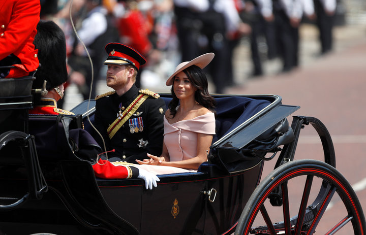 Markle in an off-the-shoulder Carolina Herrera dress at the Trooping the Colour. It's still a similar style to the boat neck
