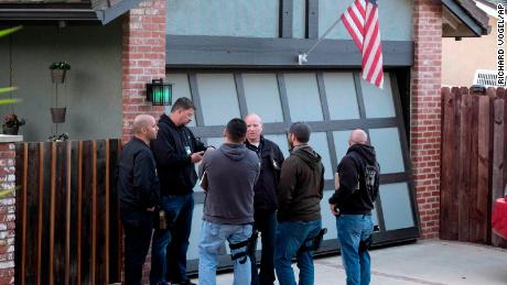 Sheriff's deputies stand outside Ian David Long's house Thursday in Newbury Park, California.
