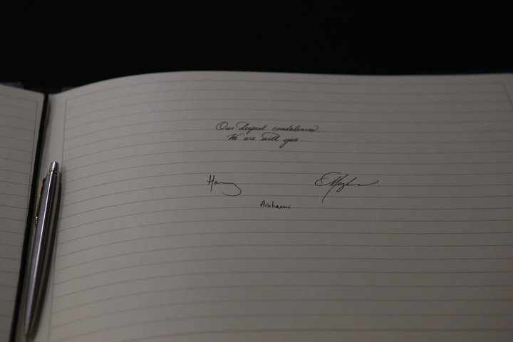 Harry and Meghan's signatures in the book of condolences.