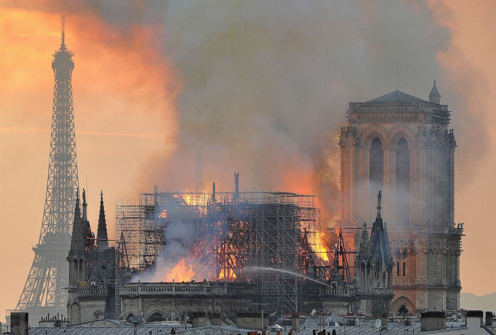 Flames and smoke rise from the blaze after the spire toppled over on Notre Dame cathedral in Paris, April 15, 2019.