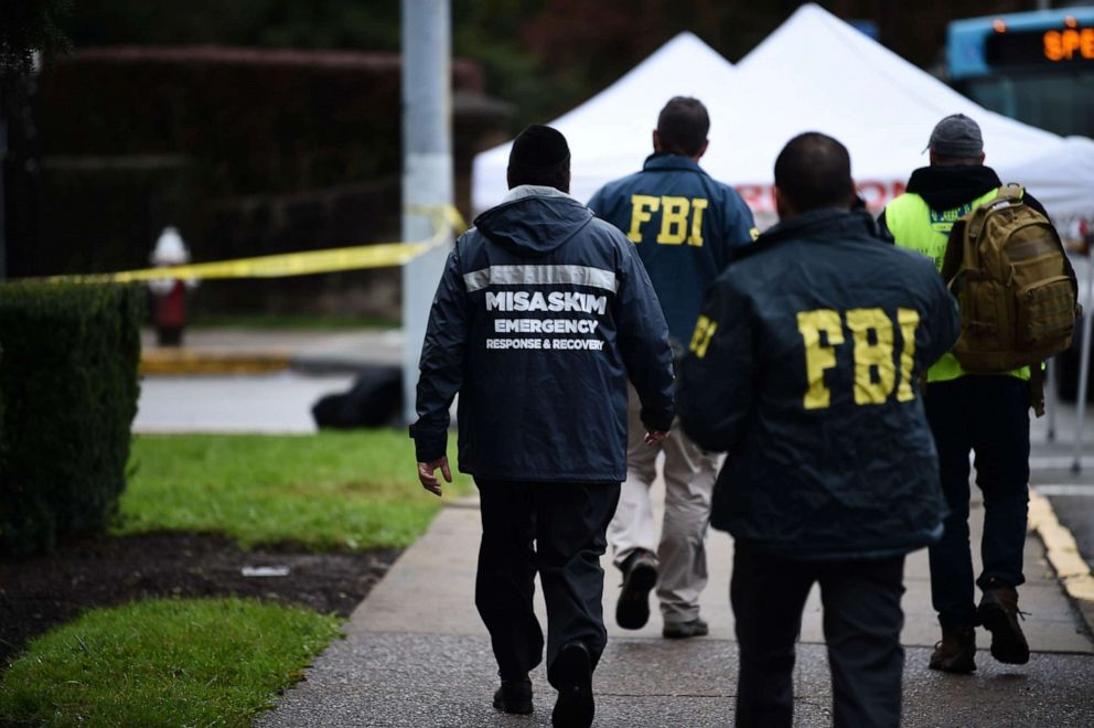 Members of the FBI and others survey the area, Oct. 28, 2018, outside the Tree of Life Synagogue after a fatal shooting in Pittsburgh.