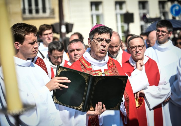 Paris Archbishop Michel Aupetit leads Holy Week celebrations near Notre Dame Cathedral on April 19, 2019, four days after a f