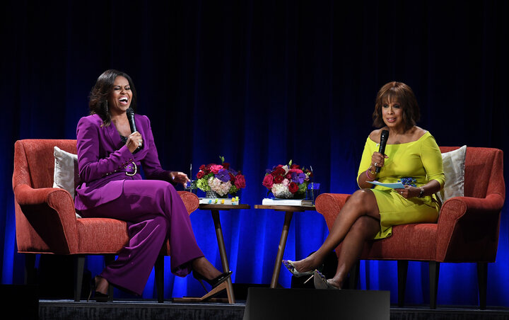 The book tour stop was moderated by Gayle King in a complementary outfit.