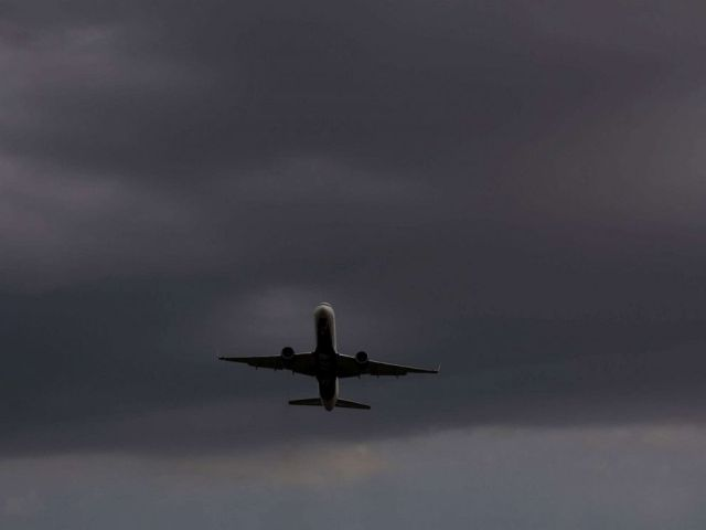 PHOTO: A plane takes off from Reagan National Airport, at Gravelly Point Park as storm clouds approach in Arlington, Va., Aug. 21, 2019.