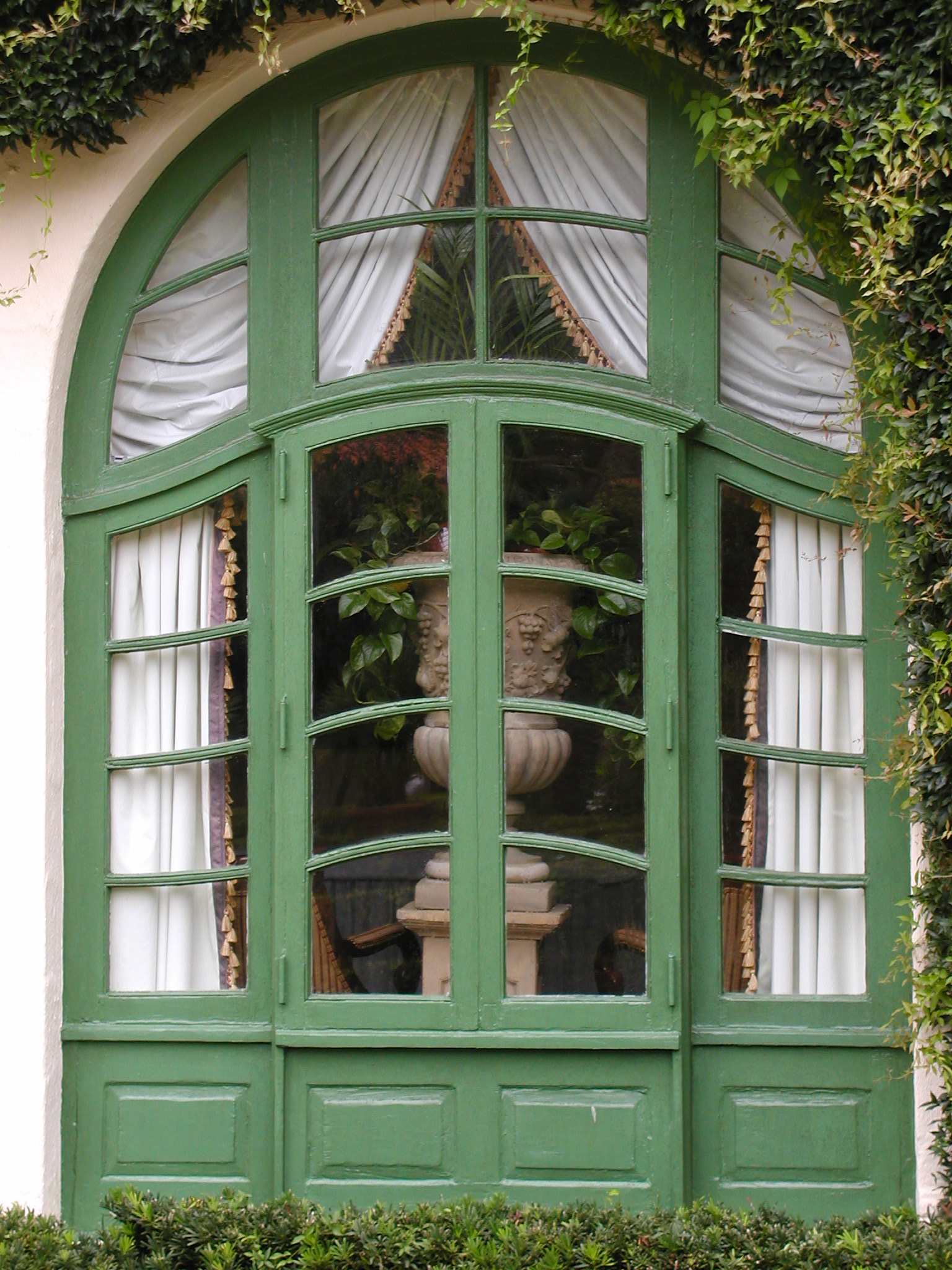 Custom French window with bowed muntins and authentic divided lights
