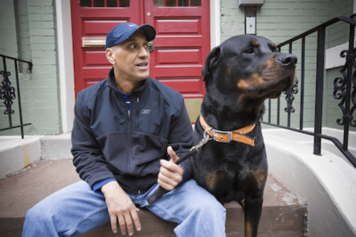 Damian Ford and his dog Michael in front of their Condo at 1217 N Street NW
