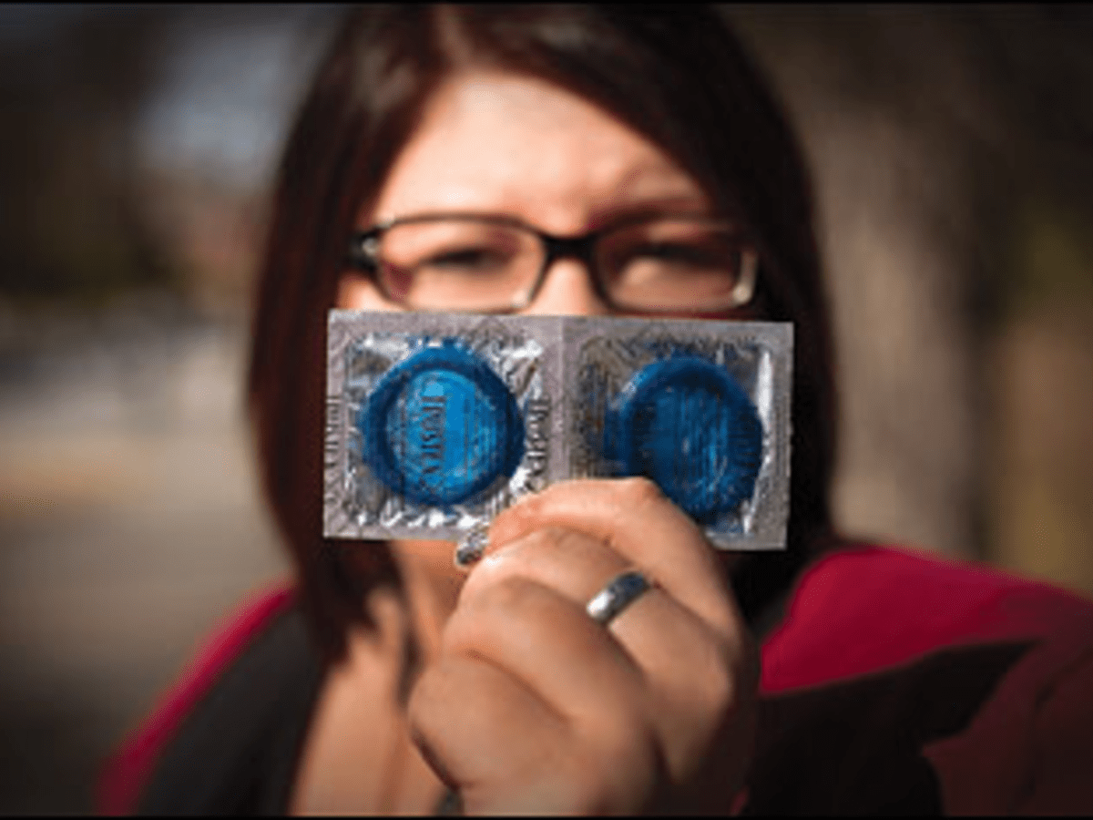 When the Rubber Hits the Road: Callie Otto goes off-campus to publicly distribute condoms.