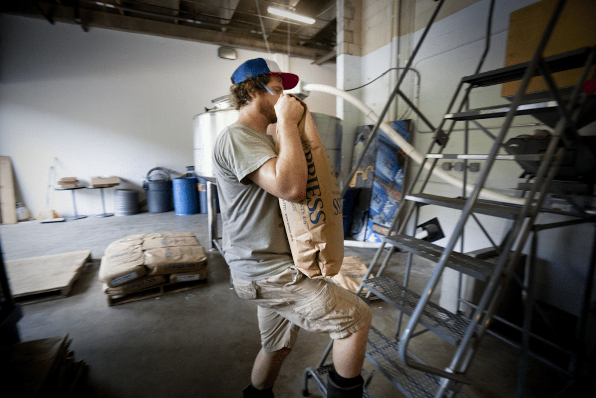Brewer Jeff Hancock of DC Brau loads grain.