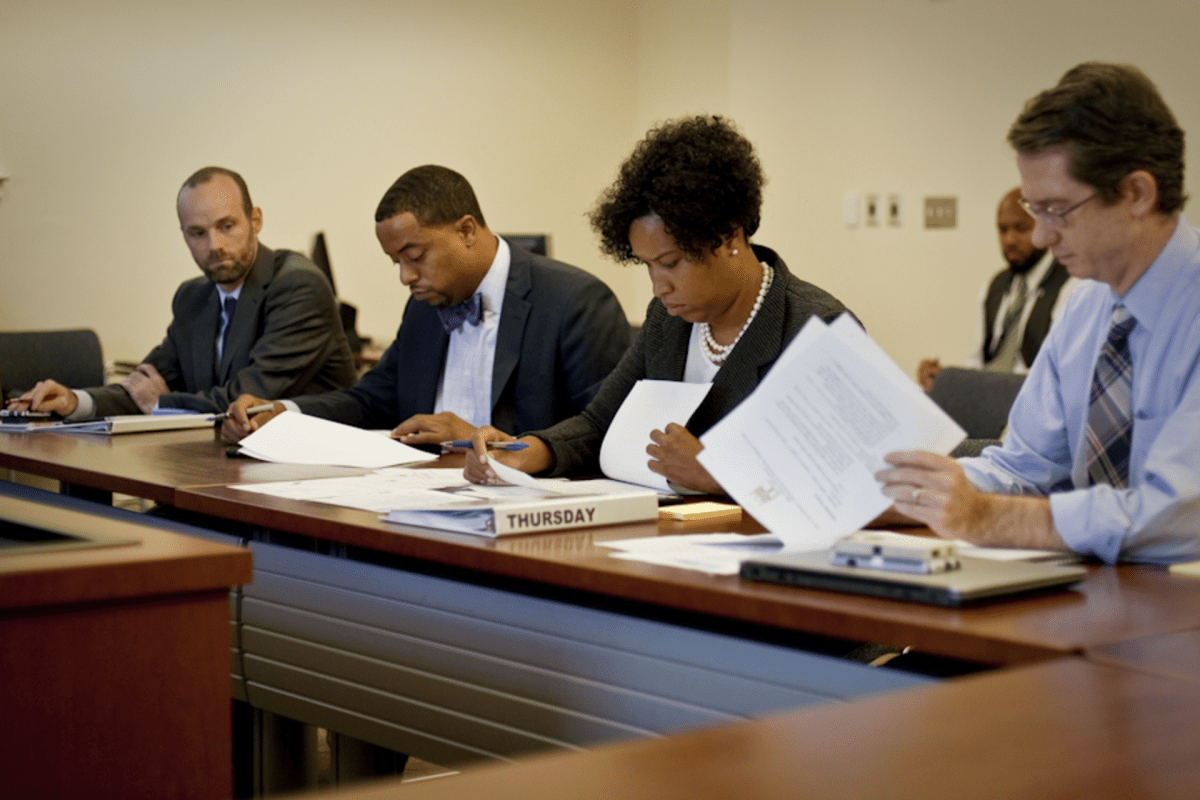 Muriel Bowser reviews homicide figures at a meeting last week
