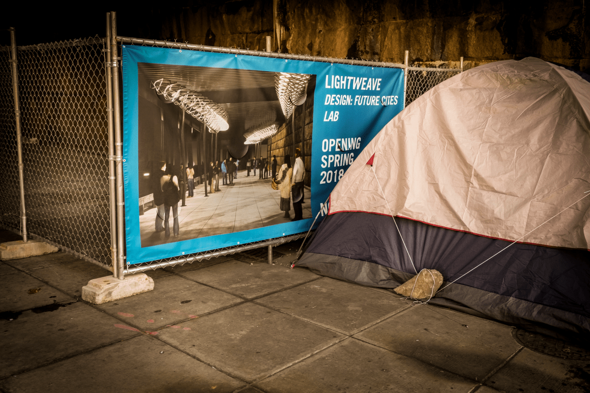 A tent under the train overpass on the 100 block of L Street NE.