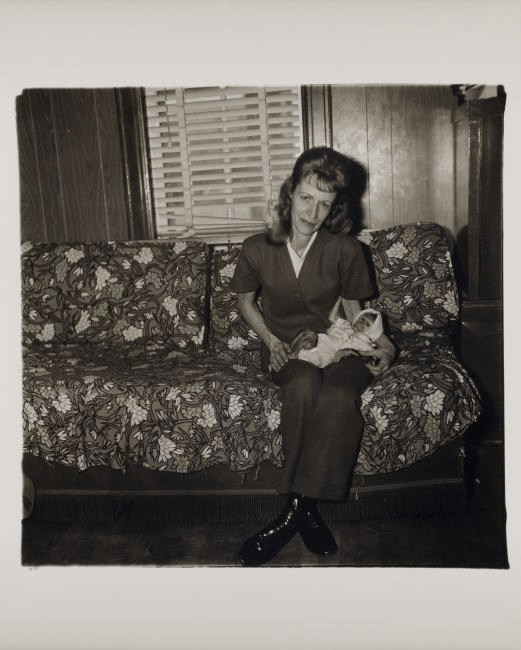 """ A woman with her baby monkey, N.J. 1971"" by Diane Arbus (1971)"