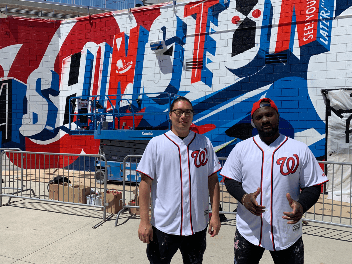 Peter Chang and Brandon Hill in front of their not-yet-completed mural